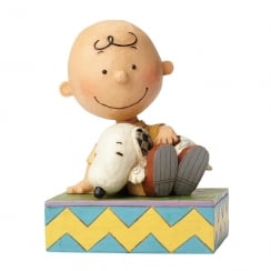 Happiness is Snuggling Charlie Brown With Snoopy Figurine